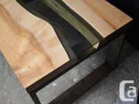 A modern maple live edge coffee table, with black glass