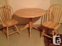 Maple Wood Dinning Table, Two Chairs That Swivel.