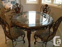 Marble table with four chairs, the middle is glass.