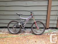 This classic DH bike is all set for a new owner. With