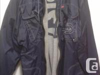 A pretty large Mark Ecko reversible jacket, in good