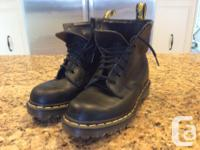Below is a pair of initial doc marten mid increase