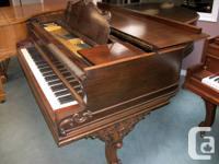 "Mason & Risch grand 6'8"" in mahogany Art case."