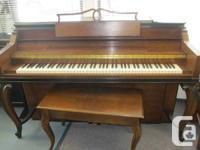 Mason & Risch small piano with antique look for sale.