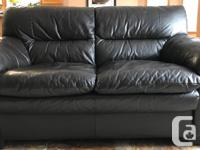 Matching leather couch & love seat in good used