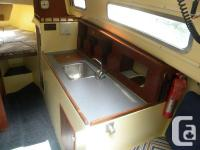 23 foot sailboat. For sale or trade. Sleeps 5.Full