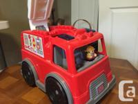 Mega Bloks firetruck by Mattel. Sturdy truck has a