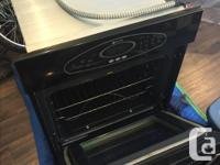 This wall oven is in perfect shape, comes with three