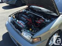 Make Mazda Model Familia Year 1993 Colour Grey kms