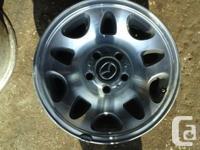Four factory 15x7 Aluminum 10 slot, 5 lug wheels with