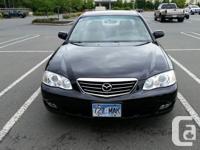 Make Mazda Model Millenia Year 2002 Colour Black