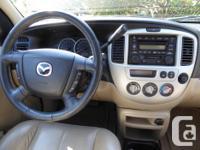 Make Mazda Model Tribute Year 2004 Colour Maroon kms