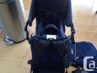 Blue MEC backpack for hiking. Toddler sits in the back.