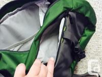 Green MEC backpack, goes over just a shoulder, easy to
