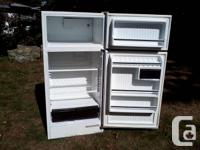 White Westinghouse medium size fridge that can be seen