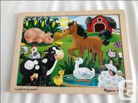 Several Melissa and Doug wooden puzzles. Stringing Set