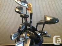 Men's golf clubs which includes a Taylor Made Driver