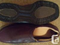 Excellent condition, barely worn. Coffee brown leather