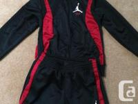 Black with red Jordan's tracksuit available! The item