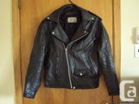 This sturdy, black, bomber-style men's leather jacket