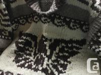 This sweater is in excellent condition, is hand spun,