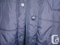 Polyester/ nylon Two zippered pockets One snap pocket