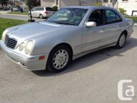 Classic silver 2001 Mercedes E320 4MATIC for sale. Runs