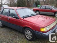 Make Mercury Model Topaz Year 1994 Colour Red kms