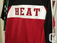 I have two sets of Miami Heat basketball warmup gear.