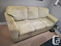 This is a gently used, light green microfibre couch for
