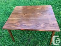 Mid Century Modern Teak dining table. Beautiful grain