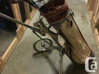 12 clubs with Spalding golf bag and wheeled cart with
