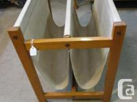 THIS TEAK PAPER RACK IS 22 INCHES LONG, 12 1/2 INCHES