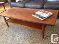 Nice vintage walnut coffee table, shelf underneath for