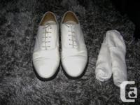 Selling this pair of white shoes that includes two