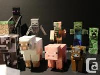 15 Paper-craft minecraft figures, and 1 plastic
