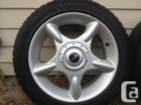 For sale is 4 mimi cooper rims. 2 tires have good tread
