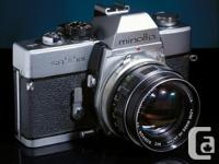 This 35 mm handbook film electronic camera has 50 mm as