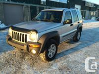 Make Jeep Model Liberty Year 2002 Colour Silver kms