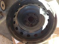 """For sale Used like New 1 Steel Rim 15"""". No dent or"""