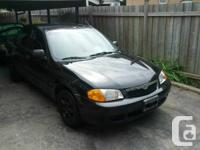 Selling my mint condition 2000 Mazda Protege Sedan with