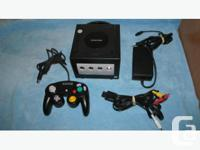 MINT GAMECUBE SYSTEM AND 1 CONTROLLER Powered by a
