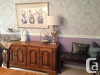 For sale is a mint condition oak dining room table, 6