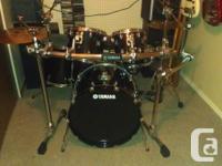 Mint condition five piece Yamaha Custom Oak drum kit.