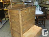 THIS CHEST IS SOLID WOOD. IT IS 32 INCHES WIDE, 18