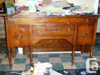 - Mahogany Drum Table 20 by 25 - $150 - Buffet $75 -