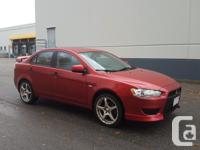 Make Mitsubishi Model Lancer Year 2009 Colour Red kms