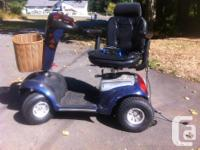 SHOPRIDER MOBILITY SCOOTER, 4 WHEEL STABLE RIDE. COMES