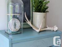 Cute modern dresser. Drawers open from cups underneath