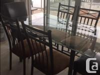 This modern glass table is in excellent condition and